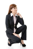 Business woman squat Royalty Free Stock Photos