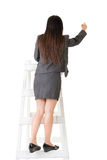 Asian business woman on stairs writing on wall Royalty Free Stock Photography