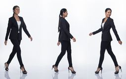 Asian Business Woman Stand in Black Formal Suit. Full Length Snap Figure, Asian Business Woman Stand in black Formal proper Suit pants and shoes, studio lighting royalty free stock photo