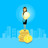 Asian Business Woman Stand On Coins Hold Light Bulb Stock Image
