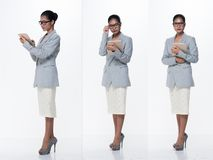 Asian Business Woman Stand in gray Formal Suit. Full Length Snap Figure, Asian Business Woman Stand Formal proper Suit skirt glasses high heel shoes, studio royalty free stock image