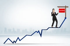 Asian business woman standing on the chart Stock Images