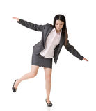 Asian business woman standing on precipice Royalty Free Stock Photos