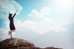 Asian business woman standing on the top of the mountain Stock Photos