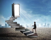 Asian business woman stepping up stair made from book Royalty Free Stock Photo