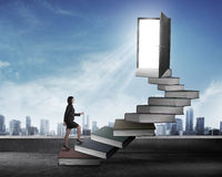 Asian business woman stepping up stair made from book Royalty Free Stock Photography