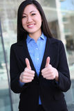 Asian Business Woman Success. A pretty asian business woman with thumbs up celebrating success Stock Images