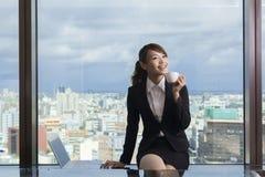 Asian business woman take a break Royalty Free Stock Photos