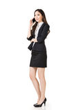 Asian business woman talking on cell phone Stock Photography
