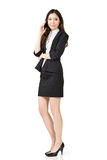 Asian business woman talking on cell phone Royalty Free Stock Photography