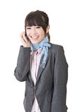 Asian business woman talking on cell phone Stock Images