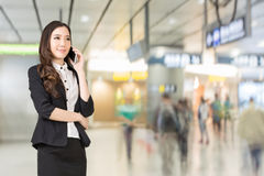 Asian business woman talking on cellphone Stock Images