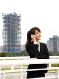 Asian business woman talking on the phone Royalty Free Stock Image
