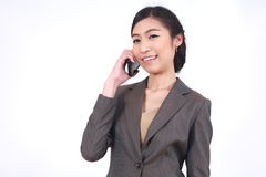 Asian Business woman talking on smart phone Royalty Free Stock Photos
