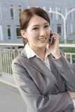 Asian business woman talking on smart phone Stock Image