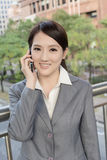 Asian business woman talking on smart phone Stock Photography