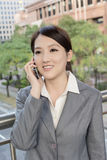 Asian business woman talking on smart phone Royalty Free Stock Images