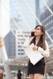 Asian business woman talking smart phone. Royalty Free Stock Image