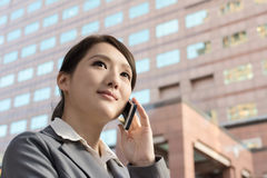 Asian business woman talking on smartphone with copyspace Stock Photography