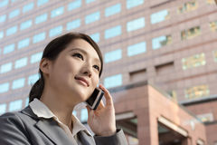Asian business woman talking on smartphone with copyspace Royalty Free Stock Photo