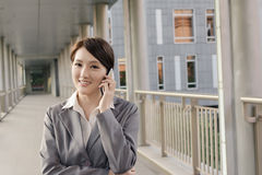 Asian business woman talking on smartphone with copyspace Royalty Free Stock Images