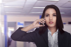 Asian business woman talking with working partner Stock Photos