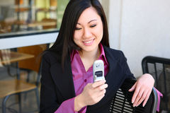 Asian Business Woman Texting With Phone Stock Photography