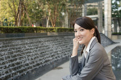 Asian business woman thinking in the city Royalty Free Stock Photos