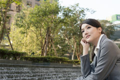 Asian business woman thinking in the city Stock Photography