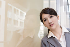 Asian business woman thinking and feel sorrow. Closeup portrait Stock Images