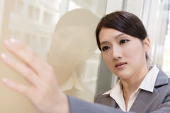 Asian business woman thinking and feel sorrow. Closeup portrait Royalty Free Stock Image