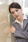 Asian business woman thinking and feel sorrow. Closeup portrait Stock Photography