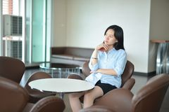 Asian business woman thinking in modern living room Stock Images