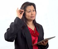 Asian Business Woman thinking at the office  Stock Photo