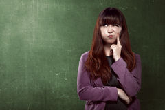 Asian business woman thinking something Royalty Free Stock Photos