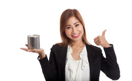 Asian business woman thumbs up with coin bank Royalty Free Stock Photos