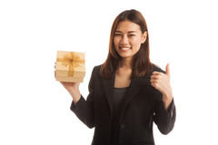 Asian business woman thumbs up with a gift box. Stock Photography