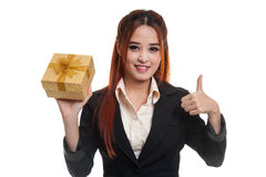 Asian business woman thumbs up with a gift box. Royalty Free Stock Photography