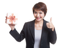 Asian business woman thumbs up with a gift box. Stock Photos