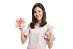 Asian business woman thumbs up with a gift box. Royalty Free Stock Image
