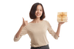 Asian business woman thumbs up with a gift box Stock Photo