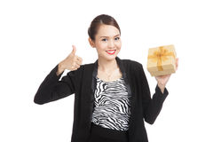 Asian business woman thumbs up with a golden gift box. Isolated on white background Royalty Free Stock Photography