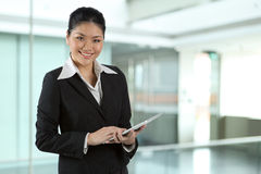Asian business woman with touch pad PC Royalty Free Stock Photos
