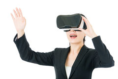 Asian business woman touch screen by VR headset glasses Royalty Free Stock Images