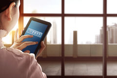 Asian business woman touch tablet with 2017 number Stock Photo