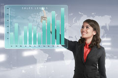 Asian business woman touching marketing sales income levels char Stock Images