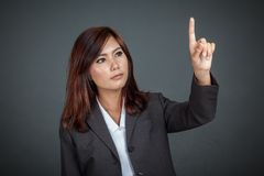 Asian business woman touching the screen Stock Image