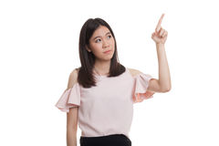 Asian business woman touching the screen with her finger. Royalty Free Stock Photo