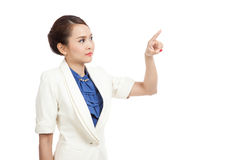 Asian business woman touching the screen with her finger Royalty Free Stock Image