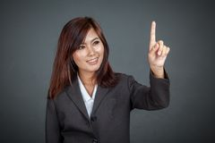 Asian business woman touching the screen and smile Royalty Free Stock Photo